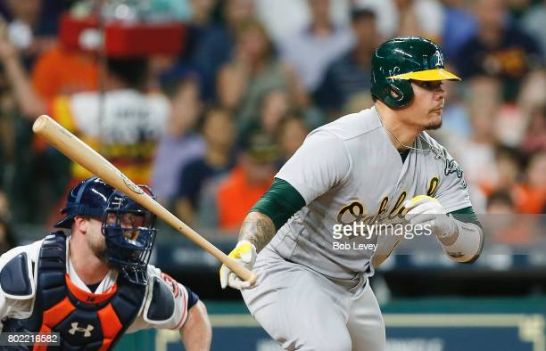 Bruce Maxwell of the Oakland Athletics singles in a run in the second inning against the Houston Astros at Minute Maid Park on June 27 2017 in...
