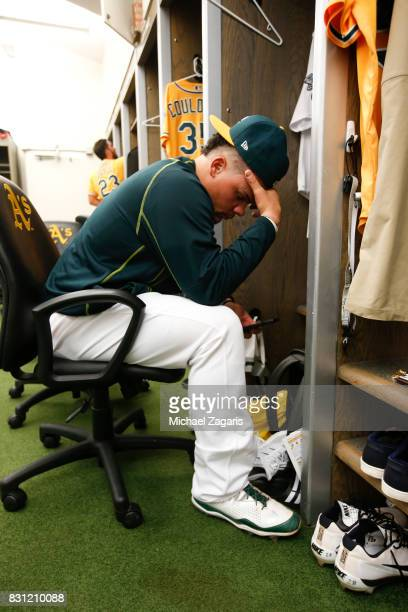 Bruce Maxwell of the Oakland Athletics sits at his locker in the clubhouse prior to the game against the Minnesota Twins at the Oakland Alameda...