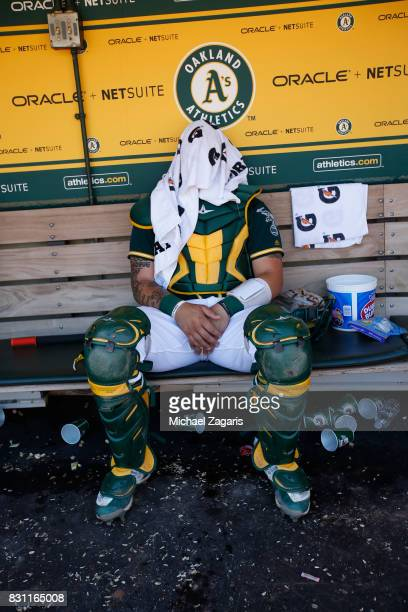 Bruce Maxwell of the Oakland Athletics sits in the dugout during the game against the Tampa Bay Rays at the Oakland Alameda Coliseum on July 19 2017...
