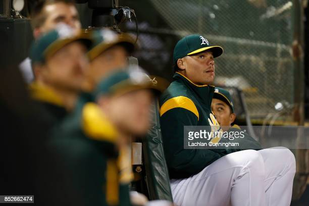Bruce Maxwell of the Oakland Athletics sits in the dugout during the game against the Texas Rangers at Oakland Alameda Coliseum on September 23 2017...