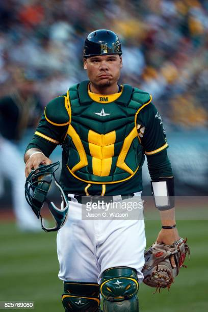 Bruce Maxwell of the Oakland Athletics stands on the field during the first inning against the San Francisco Giants at the Oakland Coliseum on July...