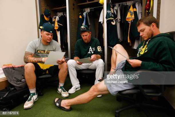 Bruce Maxwell Pitching Coach Scott Emerson and Sonny Gray of the Oakland Athletics go over batters in the clubhouse prior to the game against the...