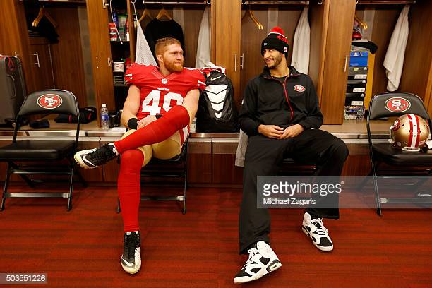 Bruce Miller and Colin Kaepernick of the San Francisco 49ers relax in the locker room prior to the game against the St Louis Rams at Levi Stadium on...