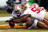 Bruce Miller and Eli Harold of the San Francisco 49ers scramble to grab the football in the second quarter against the Chicago Bears at Soldier Field...