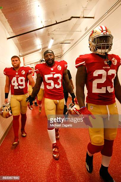 Bruce Miller NaVorro Bowman and Will Redmond of the San Francisco 49ers head to the field prior to the game against the Houston Texans at Levi...