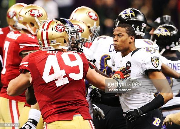 Bruce Miller of the San Francisco 49ers and Cary Williams of the Baltimore Ravens exchange words in the first half during Super Bowl XLVII at the...
