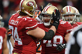 Bruce Miller of the San Francisco 49ers celebrates after scoring a touchdown with Joe Staley during their NFL game at Levi's Stadium on December 20...