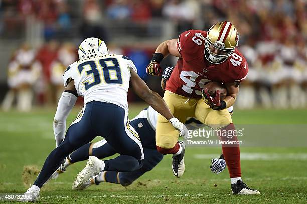 Bruce Miller of the San Francisco 49ers challenges the defense of Marcus Gilchrist of the San Diego Chargers in the first half at Levi's Stadium on...