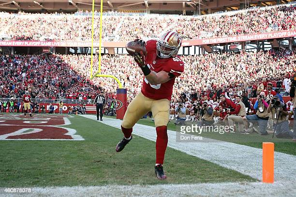 Bruce Miller of the San Francisco 49ers completes a pass for a touchdown in the third quarter against the Arizona Cardinals at Levi's Stadium on...
