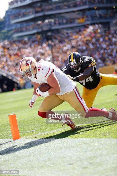 Bruce Miller of the San Francisco 49ers grabs the ball in the end zone but officials ruled he did not have possession during the game against the...