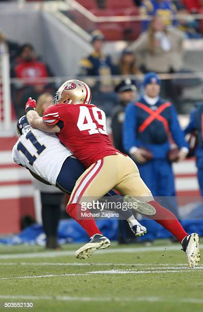 Bruce Miller of the San Francisco 49ers levels Tavon Austin of the St Louis Rams during the game at Levi Stadium on January 3 2016 in Santa Clara...