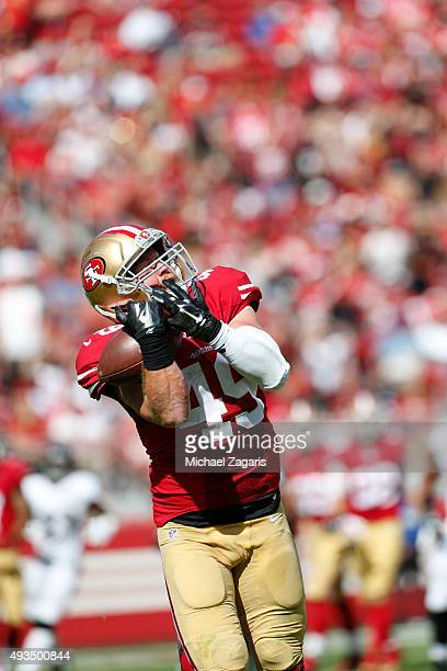 Bruce Miller of the San Francisco 49ers makes a reception during the game against the Baltimore Ravens at Levi Stadium on October 18 2015 in Santa...