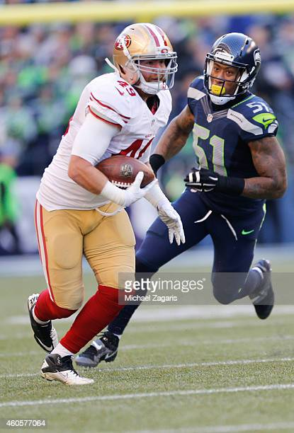 Bruce Miller of the San Francisco 49ers runs after making a reception during the game against the Seattle Seahawks at CenturyLink Field on December...