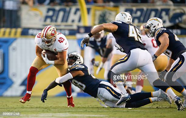 Bruce Miller of the San Francisco 49ers runs after making a reception during the game against the San Diego Chargers at Qualcomm Stadium on September...