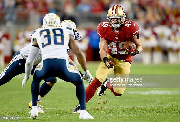 Bruce Miller of the San Francisco 49ers runs with the ball against the San Diego Chargers at Levi's Stadium on December 20 2014 in Santa Clara...