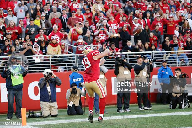 Bruce Miller of the San Francisco 49ers scores on a 3yard touchdown reception during the game against the Arizona Cardinals at Levi Stadium on...