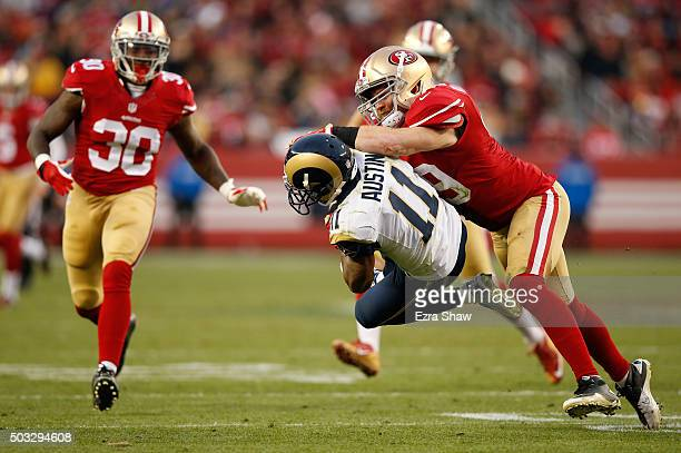 Bruce Miller of the San Francisco 49ers tackles Tavon Austin of the St Louis Rams as he fields a punt in overtime of their NFL game at Levi's Stadium...