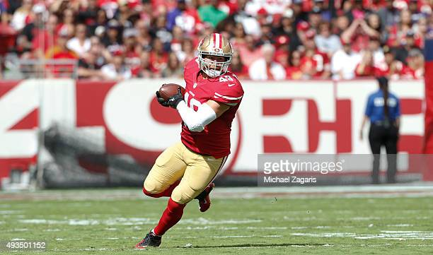 Bruce Miller of the San Francisco 49ers takes takes the ball 52yards on a touchdown reception after making a reception during the game against the...