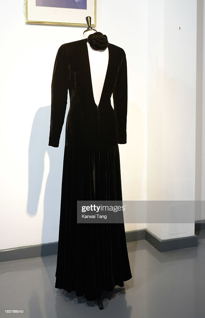 A Bruce Oldfield black velvet evening gown, worn for the official portrait by Lord Snowdon and for the first night gala opening of 'Les Miserables' at the Barbican Centre and 10th October 1985 is displayed at a photocall ahead of the the 'Fit For a Princess' auction on March 15, 2013 in London, England. 10 dresses from the collection of Diana, Princess of Wales are to be auctioned by specialist Kerry Taylor.