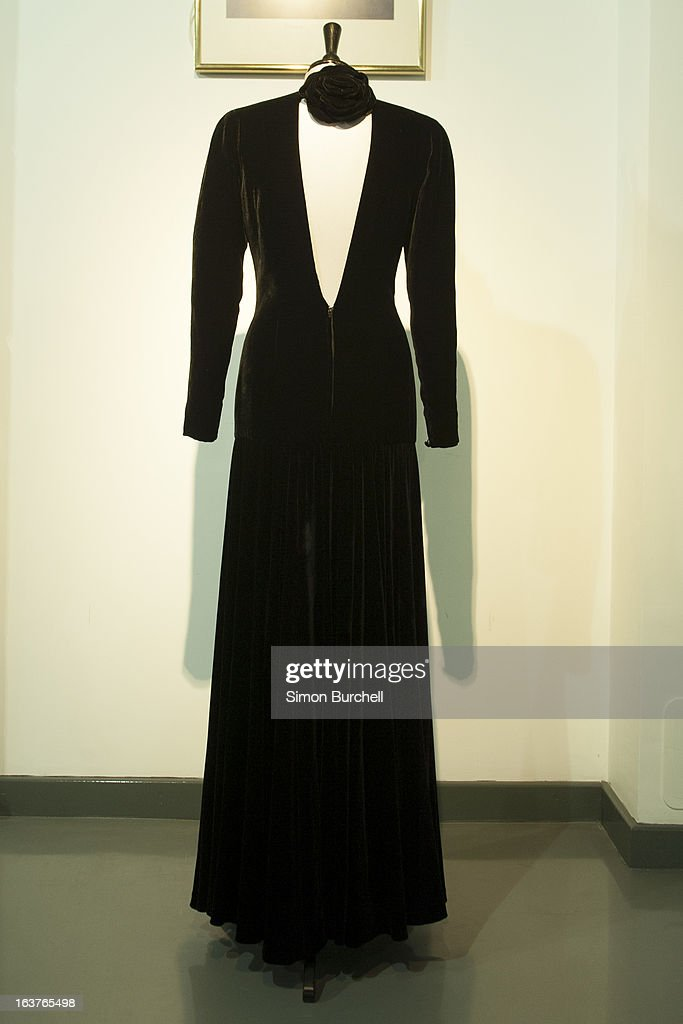 Bruce Oldfield black velvet gown worn for a Lord Snowdon Portrait 1985 is displayed at a photocall ahead of the the 'Fit For a Princess' auction on March 15, 2013 in London, England. 10 dresses from the collection of Diana, Princess of Wales are to be auctioned by specialist Kerry Taylor.