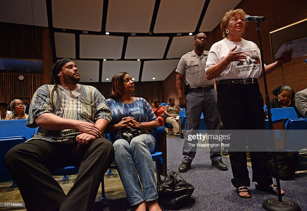 Bruce Purnell and wife Ronnie Blackstone listen as Dorothy Copp Elliott talks about losing her son Archie to racial profiling over two decades ago during a forum on youth violence in Capitol Heights, MD on August 20, 2013. Men Aiming Higher, a non-profit youth advocacy group in Prince Georges County sponsored tonight's forum on youth violence. Last year a student was shot at Suitland High School by another student over a pair of Timberland shoes. Another kid was shot at Central High School after being bullied. In the wake of the Trayvon Martin case, Men Aiming Higher invited students and community activists in PG County to talk about youth crime. The information gleened from the forum will be given to the county's police chief and states attorneys with hopes that they can prevent further violence among young people.