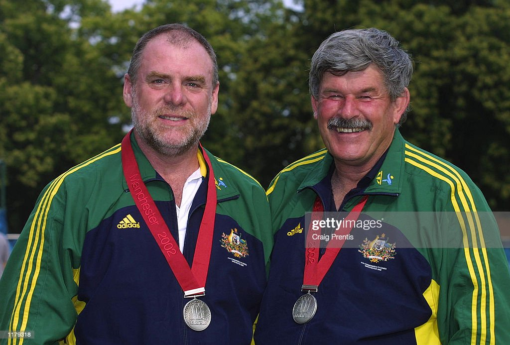 Bruce Quick [L] and Phillip Adams [R] of Australia celebrate winning silver in the Men's 25m Standard Pistol Pairs Competition in Bisley, Surrey during the 2002 Commonwealth Games in Manchester, England on July 29, 2002.