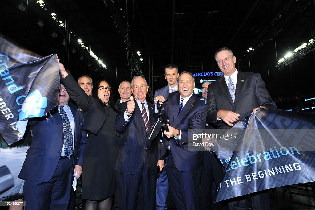 Bruce Ratner, Barclays Center Developer and Majority Owner, New York City Mayor Michael Bloomberg and Mikhail Prokhorov, Brooklyn Nets Principal Owner cut the ribbon during the Barclays Center ribbon cutting ceremony on September 21, 2012 at the Barclays Center in Brooklyn, New York.