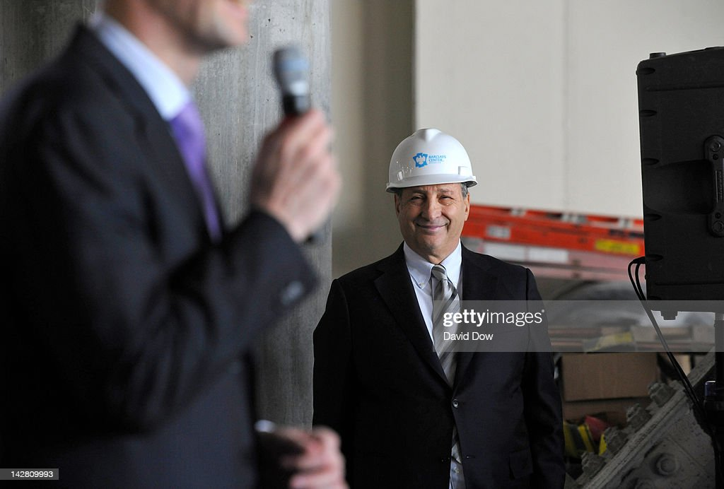 Bruce Ratner, Barclays Center Developer and Majority Owner watches Mikhail Prokhorov, Principal Owner of the New Jersey Nets addresses the media at the Barclays Center on April 10, 2012 in Brooklyn, New York.