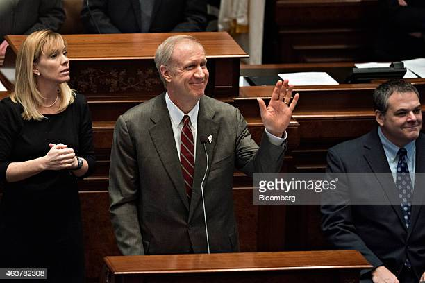 Bruce Rauner governor of Illinois center acknowledges a group of highschool students as he delivers a budget address in the House Chamber of the...