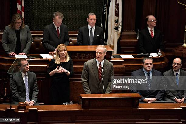 Bruce Rauner governor of Illinois center delivers a budget address in the House Chamber of the State Capitol building in Springfield Illinois US on...