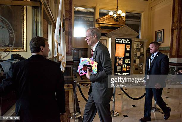 Bruce Rauner governor of Illinois center returns to his office at the Illinois State Capitol after delivering a budget address in Springfield...