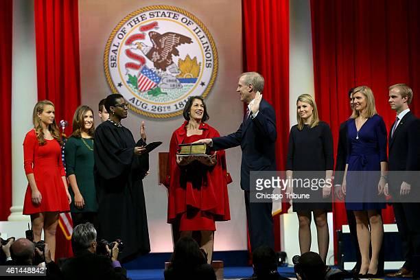 Bruce Rauner with his wife Diana by his side is sworn in as governor of the State of Illinois on Monday Jan 12 2015 at the Prairie Capital Convention...