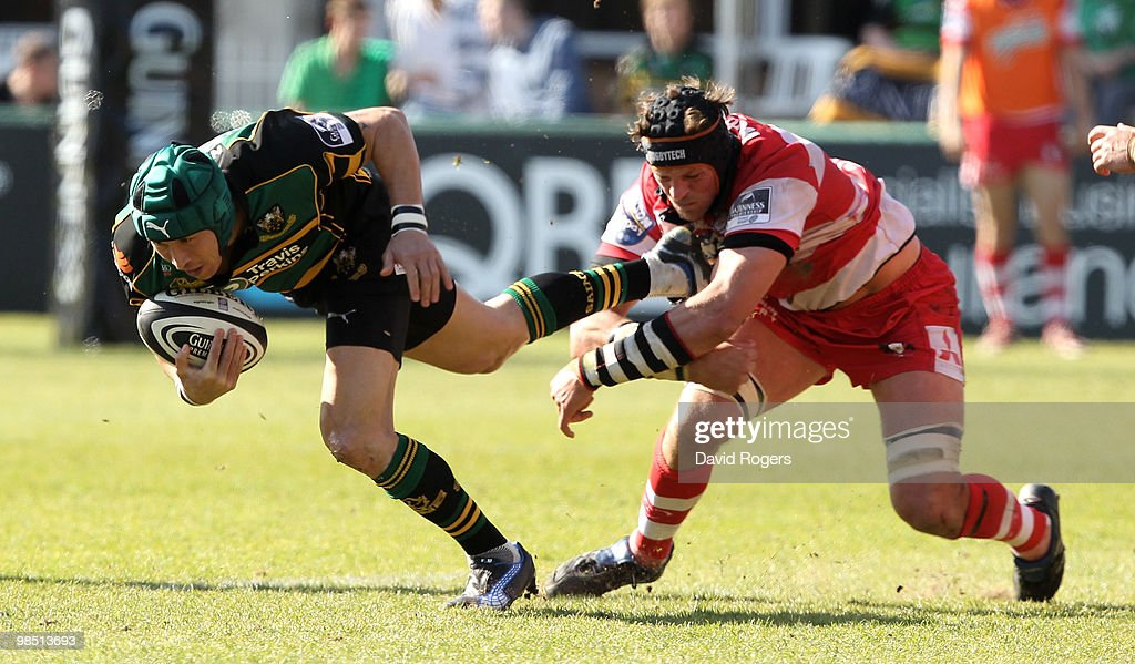 Bruce Reihana of Northampton is held by Alex Brown during the Guinness Premiership match between Northampton Saints and Gloucester at Franklin's...