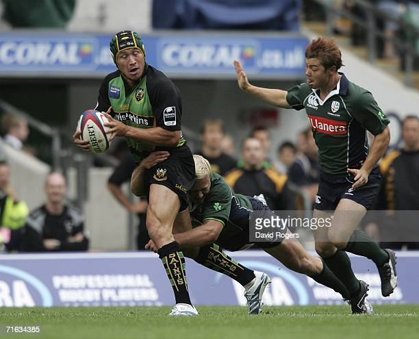 Bruce Reihana of Northampton Saints is stopped by the London Irish defence during the Coral Middlesex Sevens held at Twickenham Stadium on August 12...
