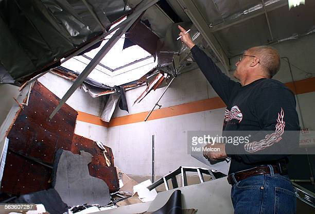 Bruce Roberts Superintendent with A/C Fire Protection Company in Ventura inspects roof collapse that was a result a collection of rain water at the...