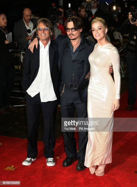 Bruce Robinson Johnny Depp and Amber Heard arriving for the European Premiere of The Rum Diary at Odeon Kensington in west London