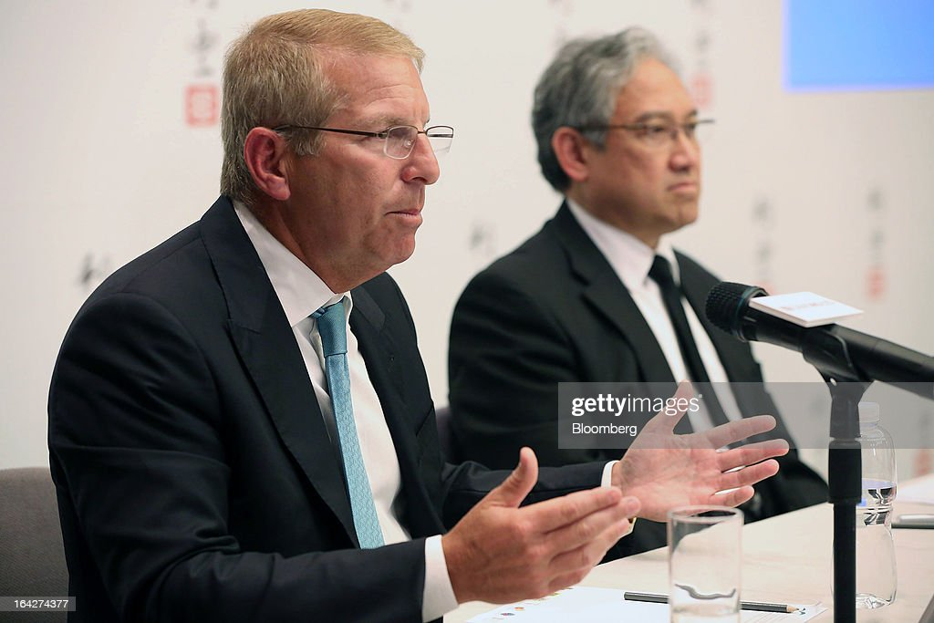 Bruce Rockowitz, chief executive officer of Li & Fung Ltd., left, speaks as William Fung, chairman, looks on at a news conference in Hong Kong, China, on Thursday, March 21, 2013. Li & Fung will miss its target for profit in 2013 after net income fell for the first time in four years at the supplier to Wal-Mart Stores Inc. and Target Corp. Photographer: Jessica Hromas/Bloomberg via Getty Images