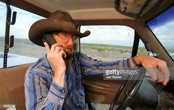 Bruce Seale a modern day cowboy stays in touch via a cell phone as he works on a ranch July 22 in El Paso Texas The Cellular Telecommunications...