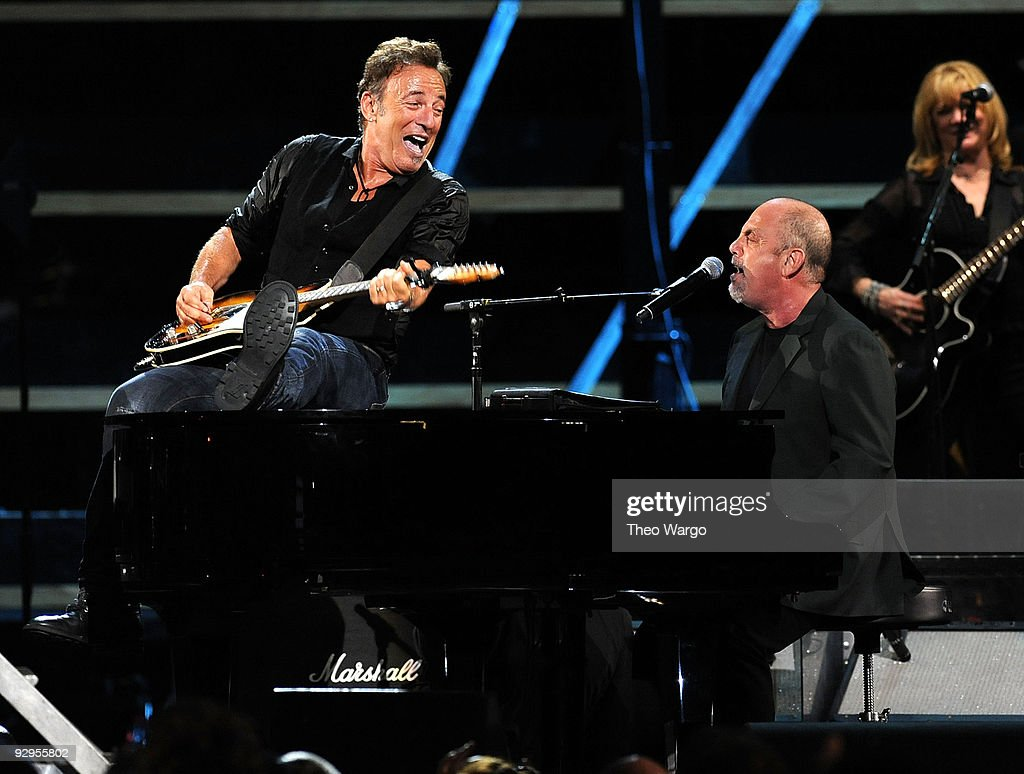 Bruce Springsteen and Billy Joel perform onstage at the 25th Anniversary Rock & Roll Hall of Fame Concert at Madison Square Garden on October 29, 2009 in New York City.