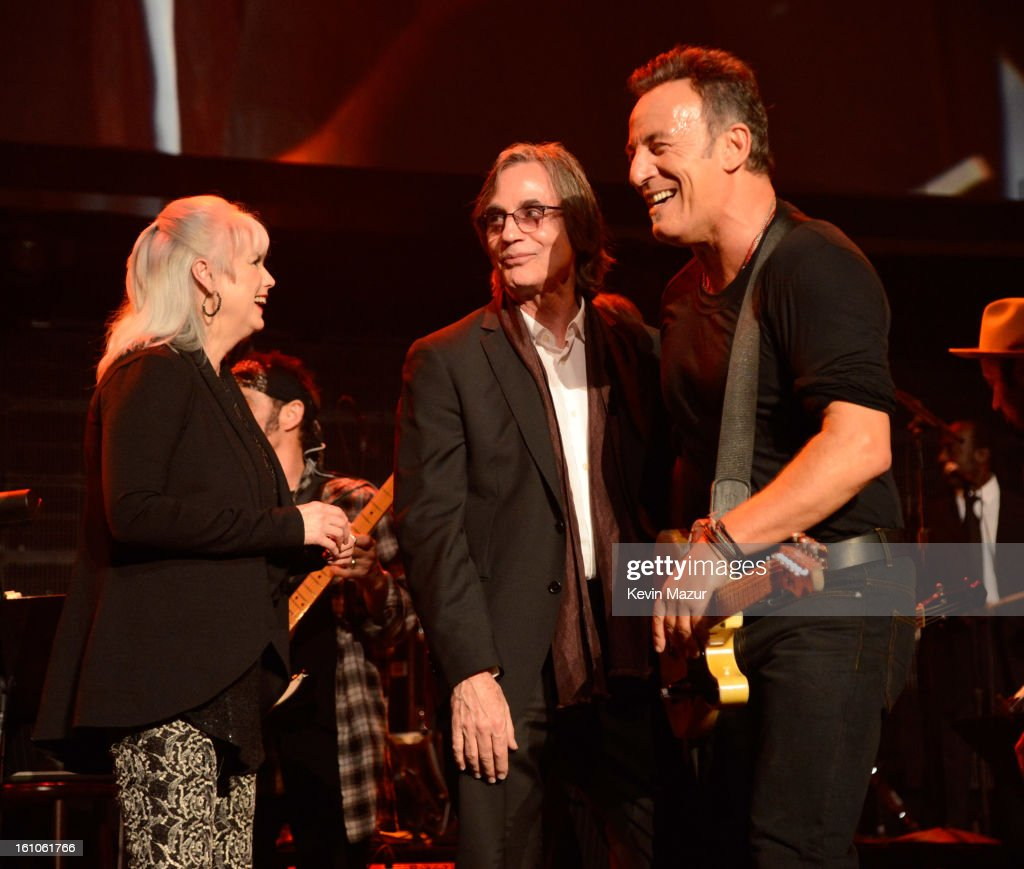 Bruce Springsteen and Emmylou Harris perform onstage at MusiCares Person Of The Year Honoring Bruce Springsteen at Los Angeles Convention Center on February 8, 2013 in Los Angeles, California.