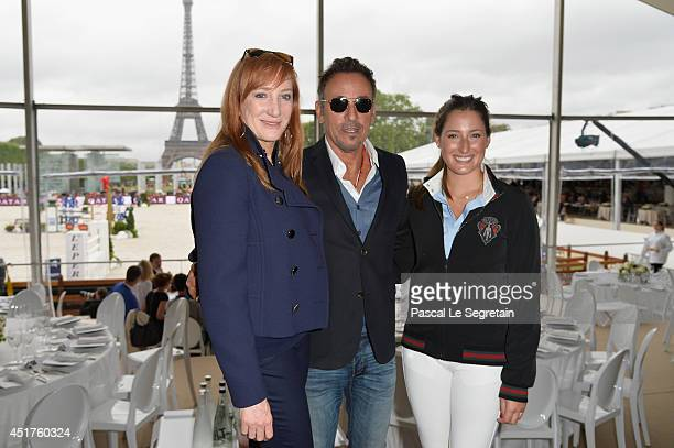 Bruce Springsteen and his wife Patti Scialfa pose with their daughter Jessica Springsteen during the Paris Eiffel Jumping presented by Gucci at...