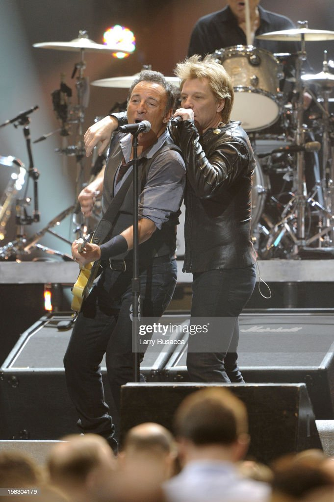Bruce Springsteen and Jon Bon Jovi (R) perform during '12-12-12' a concert benefiting The Robin Hood Relief Fund to aid the victims of Hurricane Sandy presented by Clear Channel Media & Entertainment, The Madison Square Garden Company and The Weinstein Company at Madison Square Garden on December 12, 2012 in New York City.