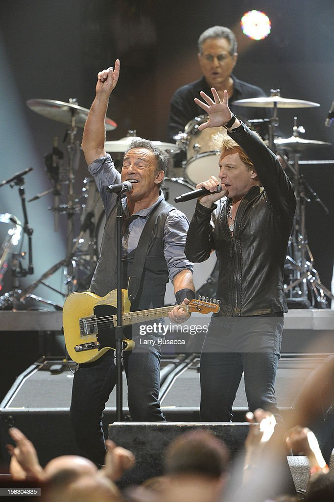 <a gi-track='captionPersonalityLinkClicked' href=/galleries/search?phrase=Bruce+Springsteen&family=editorial&specificpeople=123832 ng-click='$event.stopPropagation()'>Bruce Springsteen</a> and <a gi-track='captionPersonalityLinkClicked' href=/galleries/search?phrase=Jon+Bon+Jovi&family=editorial&specificpeople=201527 ng-click='$event.stopPropagation()'>Jon Bon Jovi</a> perform during '12-12-12' a concert benefiting The Robin Hood Relief Fund to aid the victims of Hurricane Sandy presented by Clear Channel Media & Entertainment, The Madison Square Garden Company and The Weinstein Company at Madison Square Garden on December 12, 2012 in New York City.