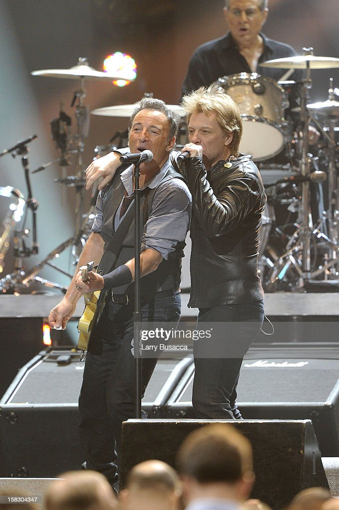 Bruce Springsteen and Jon Bon Jovi perform during '12-12-12' a concert benefiting The Robin Hood Relief Fund to aid the victims of Hurricane Sandy presented by Clear Channel Media & Entertainment, The Madison Square Garden Company and The Weinstein Company at Madison Square Garden on December 12, 2012 in New York City.
