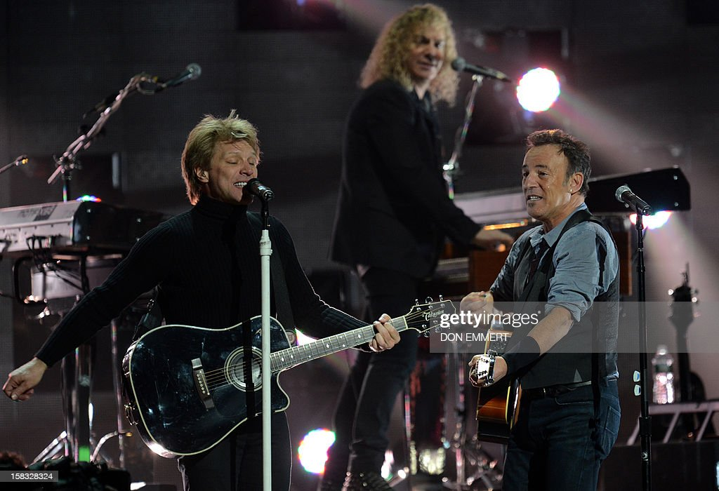 Bruce Springsteen (R) and Jon Bon Jovi perform during '12-12-12 The Concert For Sandy Relief' December 12, 2012 at Madison Square Garden in New York.