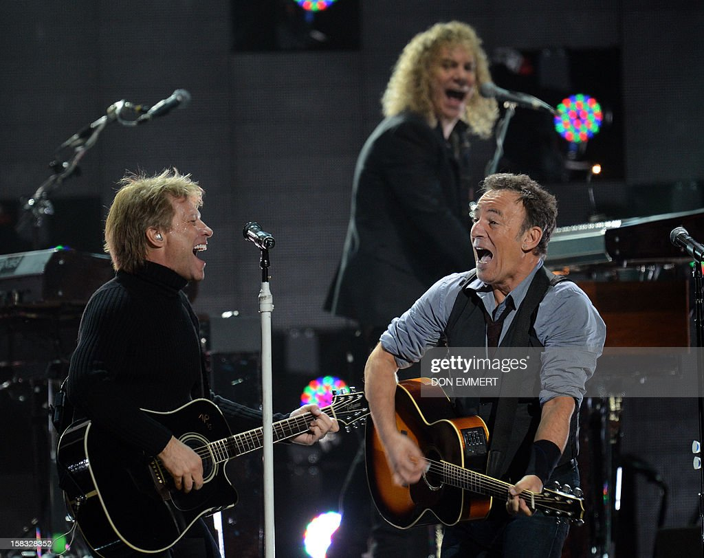 Bruce Springsteen (R) and Jon Bon Jovi (L) perform during '12-12-12 The Concert For Sandy Relief' December 12, 2012 at Madison Square Garden in New York.