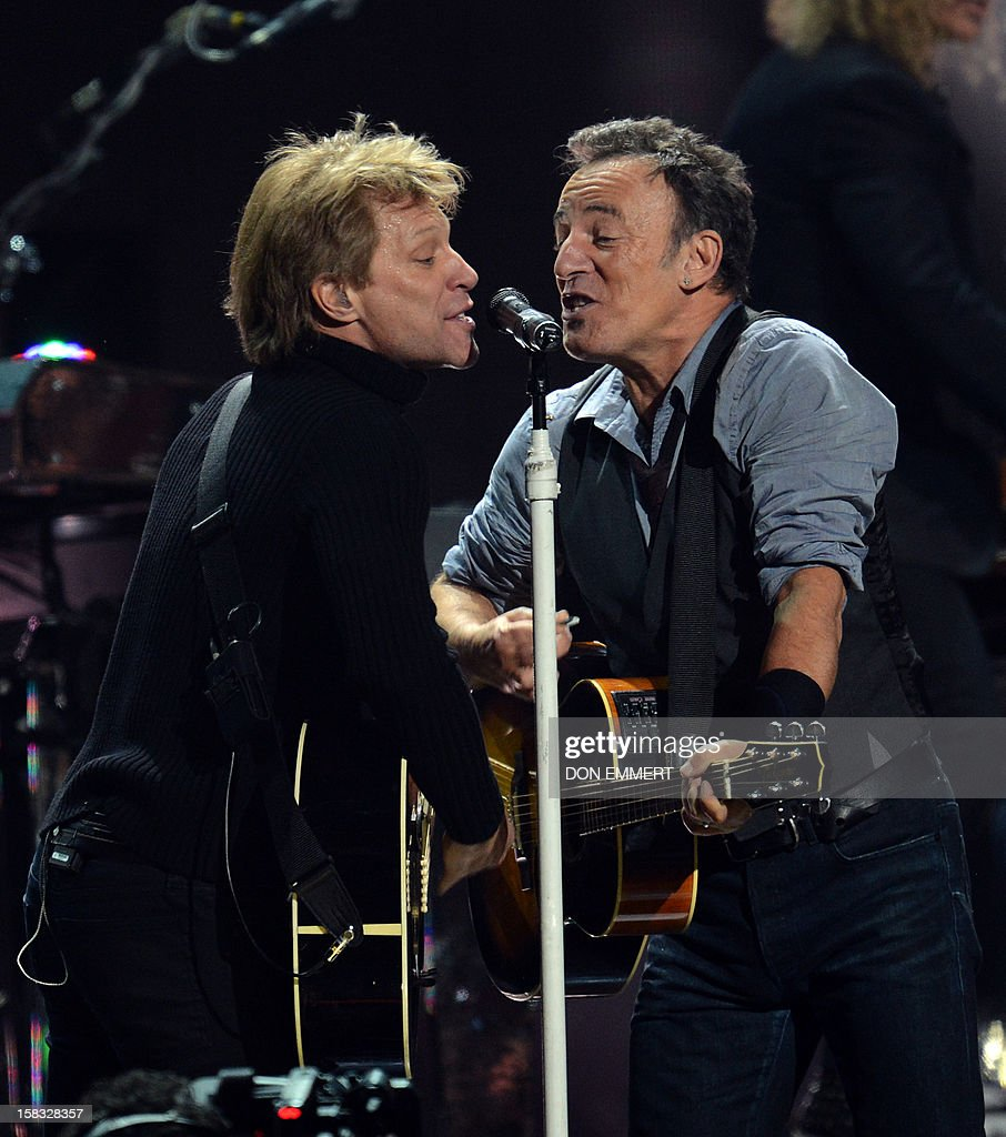 Bruce Springsteen (R) and Jon Bon Jovi (L) perform during '12-12-12 The Concert For Sandy Relief' December 12, 2012 at Madison Square Garden in New York. AFP PHOTO/DON EMMERT