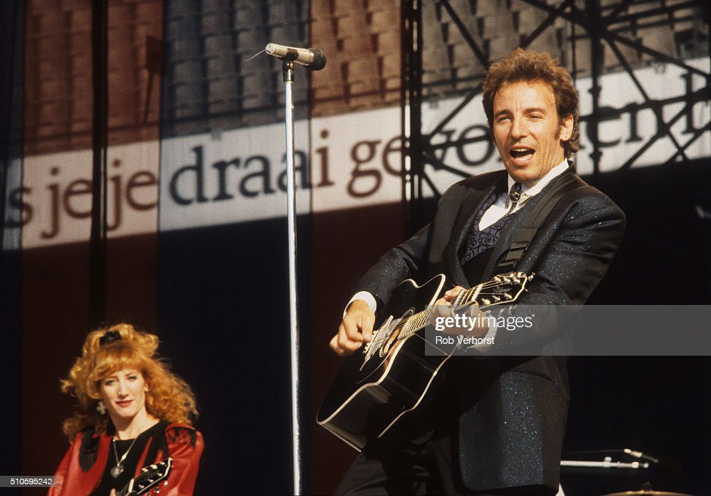 Bruce Springsteen and Patti Scialfa perform on stage on the 'Tunnel of Love' tour at Feijenoord Stadion De Kuip Rotterdam Netherlands 29th June 1988