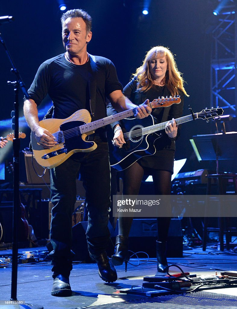 Bruce Springsteen and Patti Scialfa perform onstage at MusiCares Person Of The Year Honoring Bruce Springsteen at Los Angeles Convention Center on February 8, 2013 in Los Angeles, California.