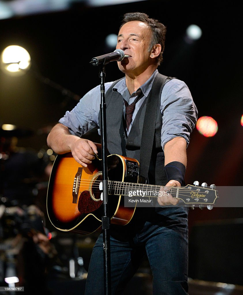 Bruce Springsteen and The E Street band perform at '12-12-12' a concert benefiting The Robin Hood Relief Fund to aid the victims of Hurricane Sandy presented by Clear Channel Media & Entertainment, The Madison Square Garden Company and The Weinstein Company at Madison Square Garden on December 12, 2012 in New York City.